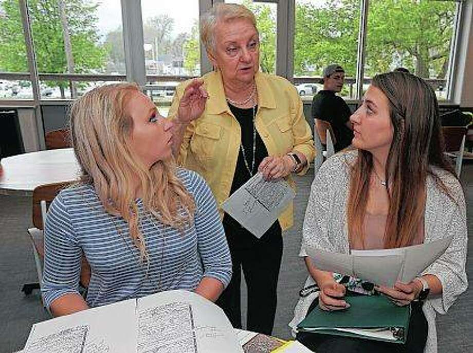 Alexia Ginter (left) and Olivia Hanson (right) speak with Clairice Hetzler before a Teen Court trial at Quincy University in Quincy. The program is set up for first-time, non-violent youth offenders. Photo: Jake Shane | Herald-Whig (AP)