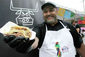 Daniel P. Hinojosa of Harris County General Store, holds his taco as he competes in the 2nd annual Tacos Over Texas, a fundraiser for the Ninfa Laurenzo Scholarship Fund on Sunday, May 19, 2019 in Houston.