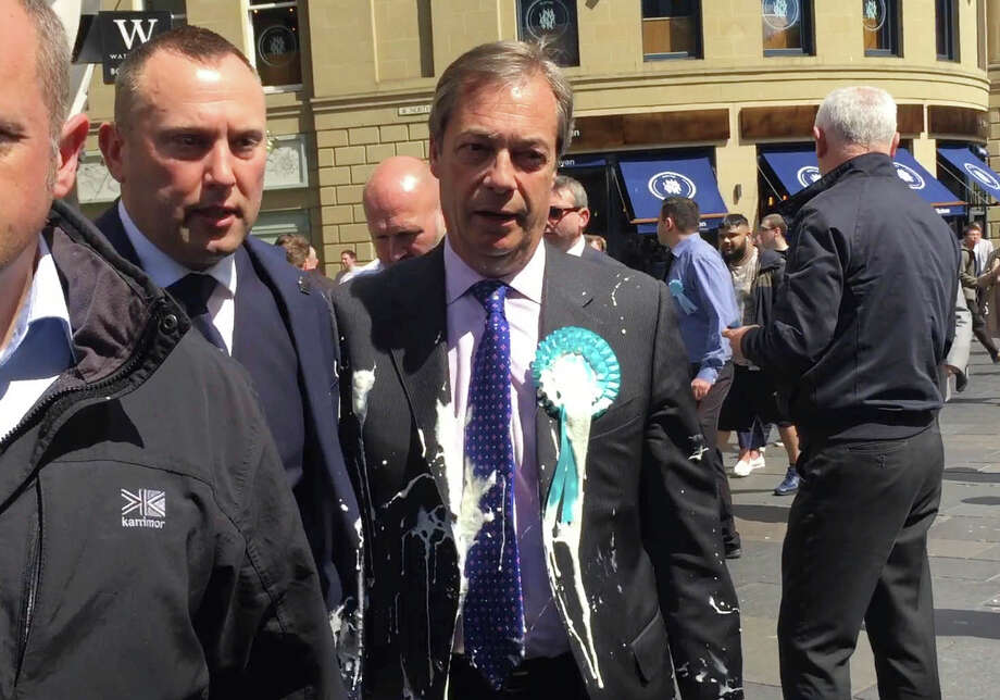 Milkshake-wielding protesters trap Nigel Farage on his Brexit bus