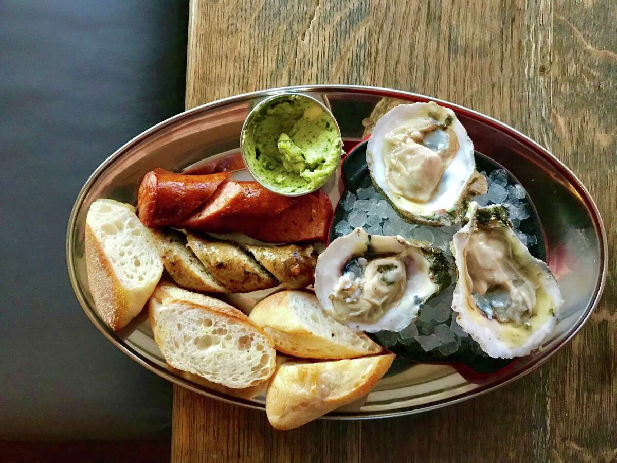 Julep bar has a new menu that includes oysters served with bourdin and andouille sausage, baguette and herb garlic butter.