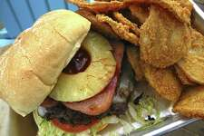 The Big Kahuna burger comes with two grilled slices of Spam over double beef patties with a slice of pineapple and a tangy-sweet Coca-Cola barbecue sauce. It's $14 with round potato fries, but spend an extra $2 and upgrade to Rojo fries, breaded like spicy fried chicken. 16080 San Pedro Ave., 210-462-1894,lucycoopers.com