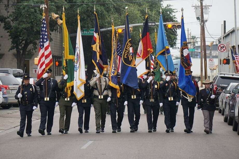 A combined law enforcement honor guard can be seen during Wednesday morning in the National Police Week Memorial at Jarvis Plaza. Authorities get together to honor the fallen. Photo: Courtesy Photo /Laredo Police Department