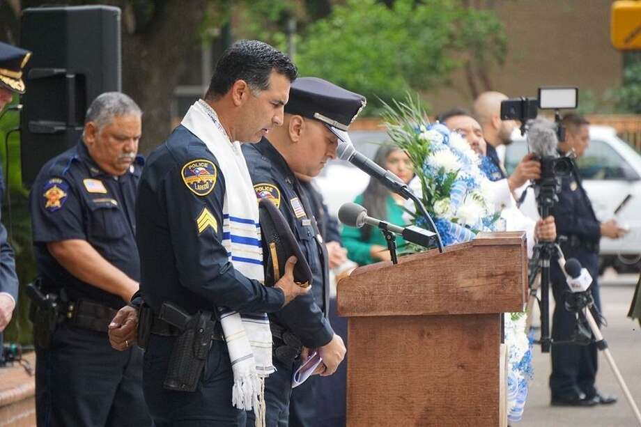 Laredo Police Sgt. Abram de la Garza leads the invocation during the National Police Week Memorial on Wednesday morning at Jarvis Plaza. Photo: Courtesy Photo /Laredo Morning Times