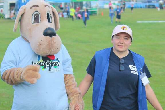 Work by volunteers such as Katie Hohman, shown with Parker the Dog, has set the city of Pearland on the path to break its annual fiscal-year record for volunteer hours spent on city-related projects.