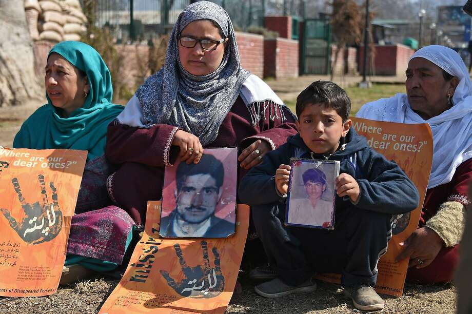 "Kashmiris demand information on missing loved ones during a protest March 10 in Srinagar. Indian troops are accused of using torture as a ""matter of policy"" in the restive region. Photo: Tauseef Mustafa / AFP / Getty Images"