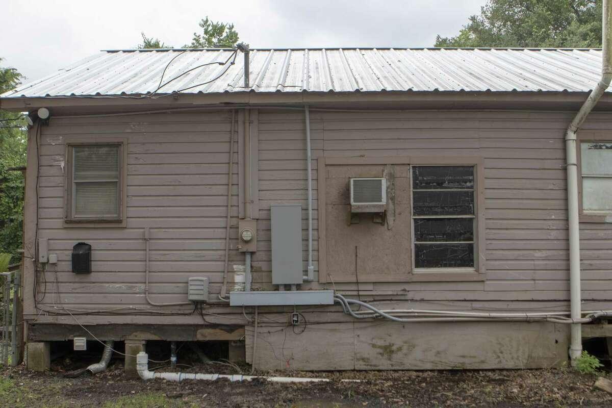 Side panelling and busted windows are seen Thursday, May 9, 2019 at Bonnie's House in Conroe. Bonnie's House offers recovering alcoholics and drug addicts a supportive living environment.