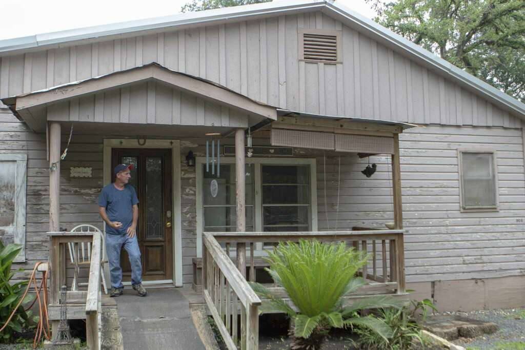 <p>Bonnie's House resident David Miller stands on the front porch of the house after finishing a cigarette Thursday, May 9, 2019 at Bonnie's House in Conroe. Bonnie's House offers recovering alcoholics and</p>