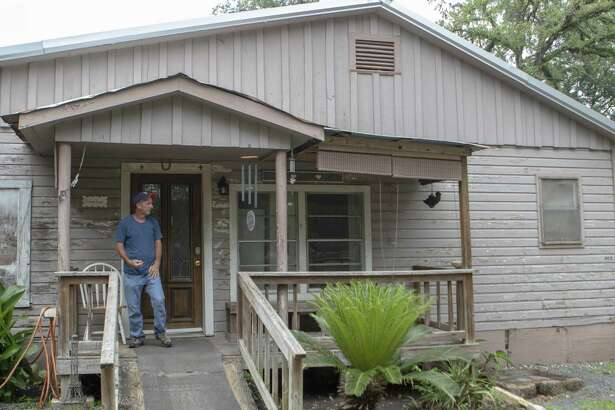 Bonnie's House resident David Miller stands on the front porch of the house after finishing a cigarette Thursday, May 9, 2019 at Bonnie's House in Conroe. Bonnie's House offers recovering alcoholics and drug addicts a supportive living environment.