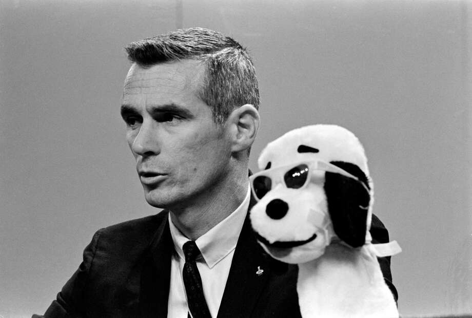 "Astronaut Gene Cernan, lunar module pilot of the Apollo 10 prime crew, is seen at a press conference on April 26, 1969, at what was then the Manned Spacecraft Center, now the Johnson Space Center. During the Apollo 10 lunar orbit operations the Lunar Module was called ""Snoopy"" when it separated from the command and service modules. The code name for the command module was ""Charlie Brown."" Photo: NASA"