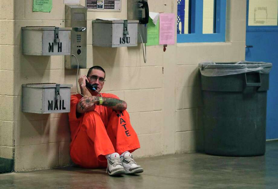 In this Nov. 27, 2017 file photo, inmate Lance Shaver talks on the phone at the Albany County Correctional Facility. Connecticut is considering legislation, which would make phone calls from prison free to inmates. Photo: Julie Jacobson / Associated Press / Copyright 2019 The Associated Press. All rights reserved.