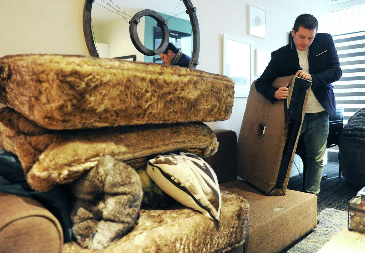 Lovesac founder and CEO Shawn Nelson re-assembles a piece of modular furniture at the Lovesac headquarters at 2 Landmark Square in downtown Stamford, Conn., on Dec. 23, 2014.