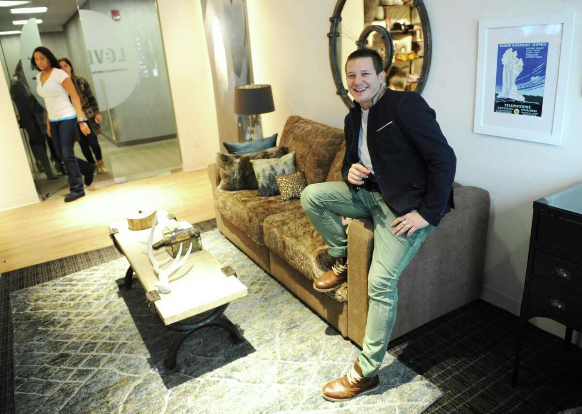 Lovesac founder and CEO Shawn Nelson sits on a piece of modular furniture at the Lovesac headquarters at 2 Landmark Square in downtown Stamford, Conn., on Dec. 23, 2014.