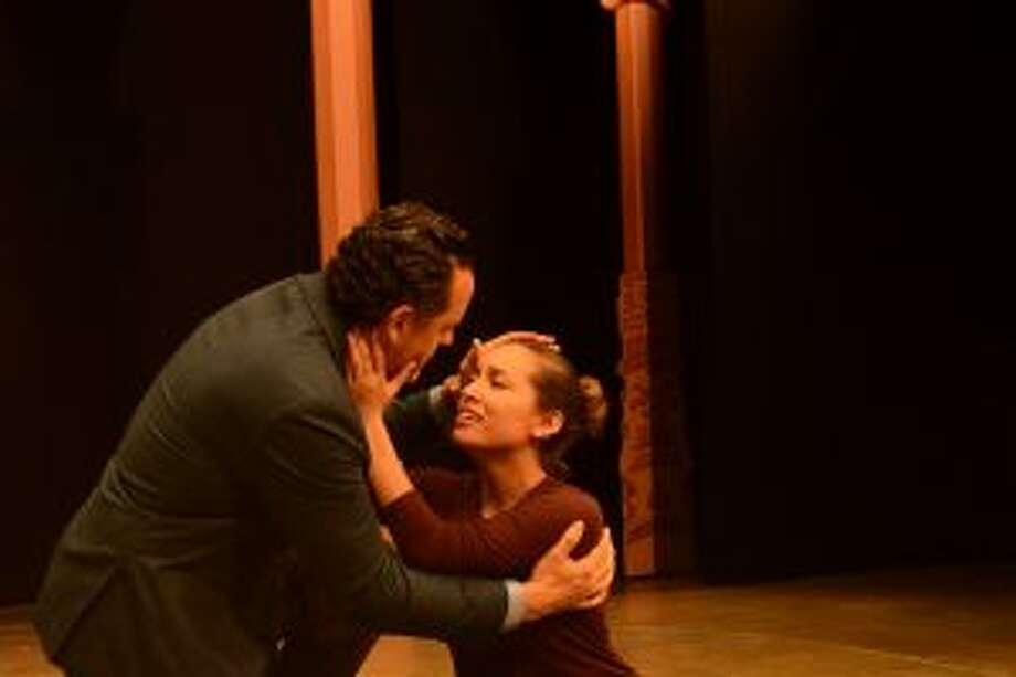 "Eva (Julia Estrada) sings ""You Must Love Me"" to Juan Peron (Ryan K. Bailer), indicating she at last realizes he loves her for herself rather than what she has done to advance his career. — Andrea Valluzzo photo"