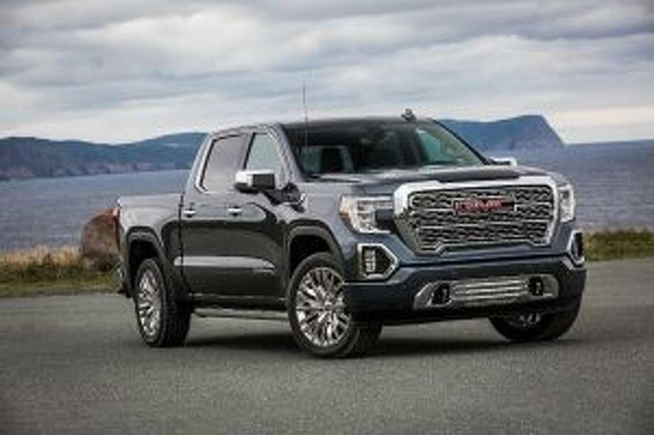 "The 2019 Sierra Denali features a ""MultiPro tailgate,"" which has configurations allowing it to be used as a step, work table or a stop for loads that are longer than the closed bed. — Courtesy of GMC Global Pressroom"