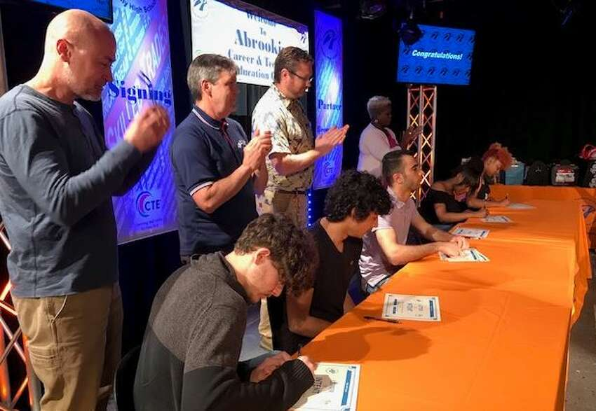 Students at Albany's Abrookin Career and Technical Education center sign commitments for jobs that are waiting for them after high school graduation in Albany, N.Y. on May 20, 2019.