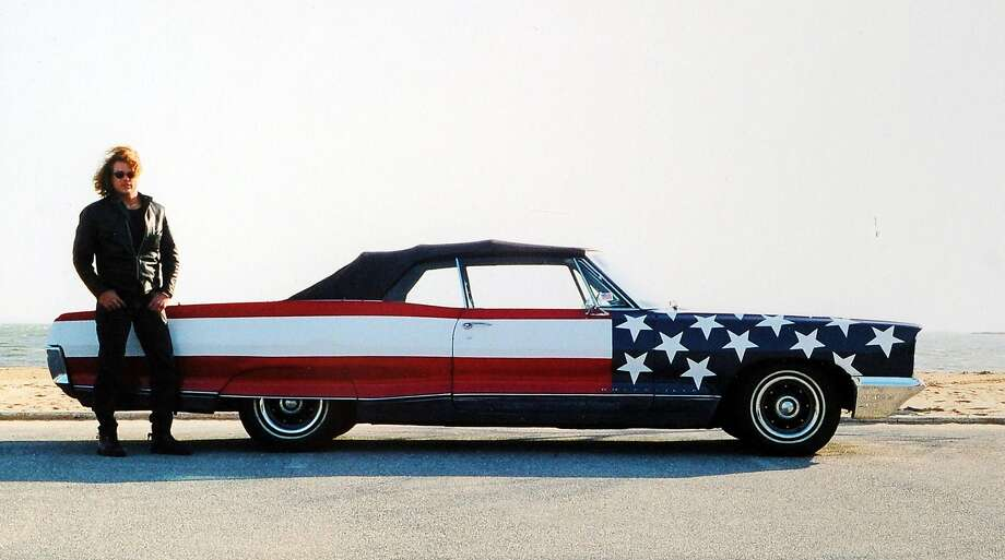 "A photographed titled ""Pontiac Muscle Car,"" taken in Darien, Conn., 2002, by Robert Carley, an artist and photographer. It was displayed at a museum show. ""Flags Across America,"" in Greenwich, Conn., in 2013. Photo: Robert Carley"
