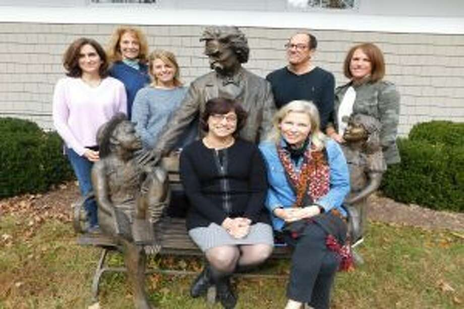 Helping to organize the Mark Twain Library's art show are, from left, standing, Katharine Dusenbury (left), Pamela Reese, Rochelle Williston, Eric Rubury, Michele Ramirez, Beth Dominianni (front) and Emily Eubanks.