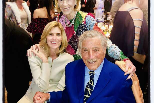 Protocol Chief Charlotte Shultz (standing) with Susan Benedetto and her husband, crooner Tony Bennett. May 4, 2019.