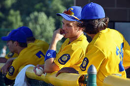 Members of the Post 199 baseball team prepare to take the field during a regular season game last year.