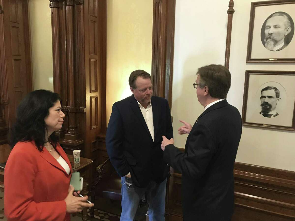 Country music star Pat Green is pushing for a bill in the Texas Legislature that would create a music incubator fund to help struggling venues in Texas continue producing a pipeline of Texas music. Green, center, is seen here speaking to Texas Lt. Gov. Dan Patrick a Republican. State Sen. Carol Alvarado is sponsoring the bill in the Texas Senate.