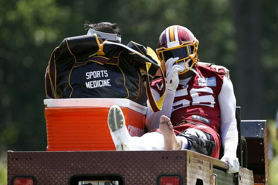 Washington Redskins linebacker Reuben Foster rides a cart off the field after suffering an injury during a practice at the team's NFL football practice facility, Monday, May 20, 2019, in Ashburn, Va. (AP Photo/Patrick Semansky) Photo: Patrick Semansky / Associated Press