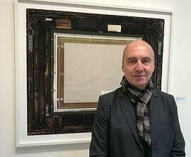 Philippe Gronon in front of the back of Courbet's 'Origin of the World'