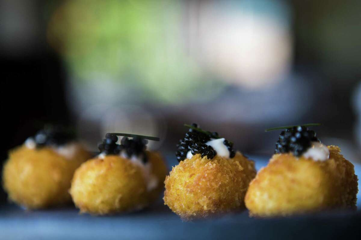 Riel restaurant tops its hand-crafted tater tots with creme fraiche and caviar.