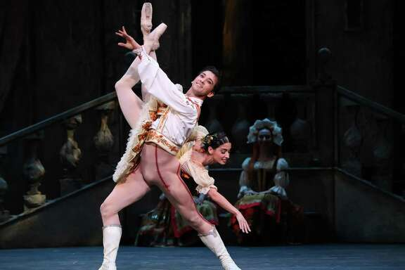 "Houston Ballet principals Charles-Louis Yoshiyama and Karina Gonzalez are terrifically spirited as Frianz and Swanilda in Ben Stevenson's ""Coppelia."""