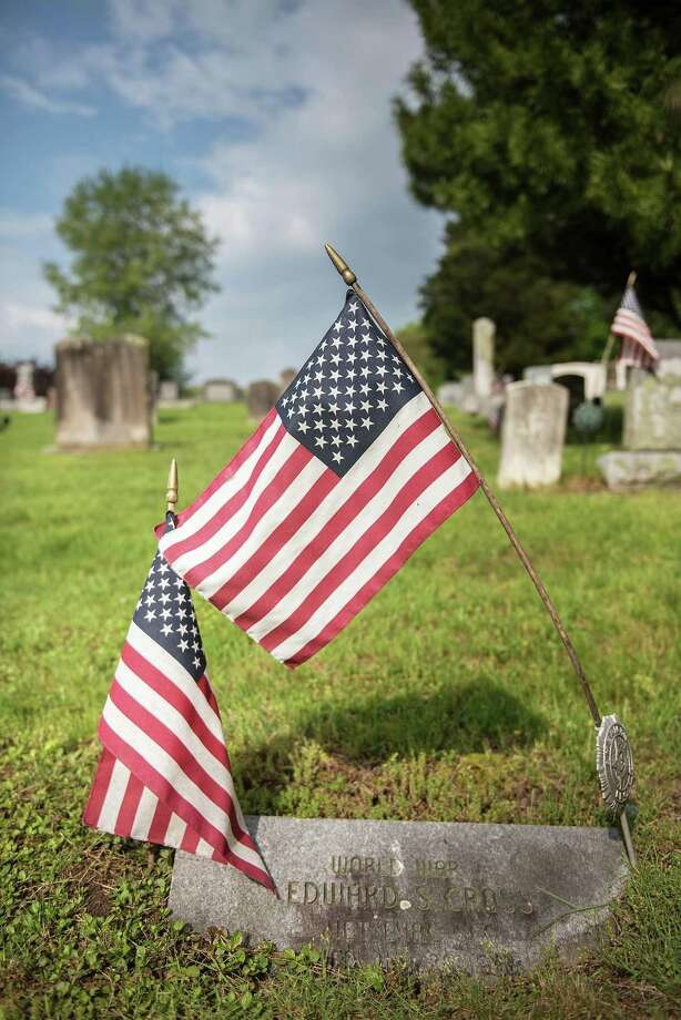 Flags mark the graves of veterans at Hillside Cemetery in Wilton, Conn. Photo: File Photo / BryanHaeffele