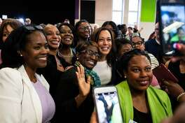 FILE-- Sen. Kamala Harris (D-Calif.), a Democratic presidential hopeful, takes a photo following an American Federation of Teachers event on teacher's pay and education in Detroit, May 6, 2019. Harris on May 20 announced a proposal to close the gender wage gap by requiring larger companies to certify that men and women are paid equally, in an effort to combat wage discrimination on a federal level. (Brittany Greeson/The New York Times)