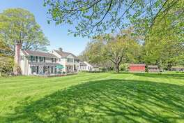 In the backyard there is a large flagstone patio, raised vegetable beds, a barn, chicken coop and plenty of room for a couple of horses.