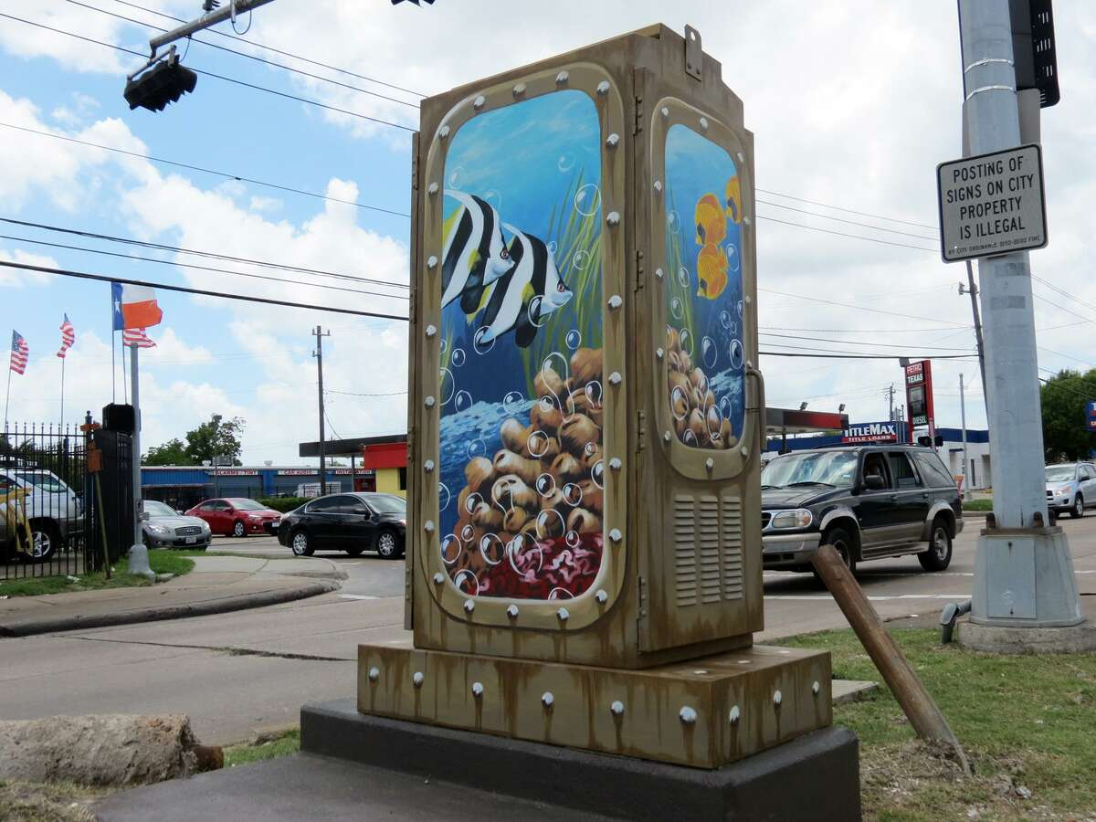 One of the traffic light boxes in Houston that has been transformed by Mini Murals
