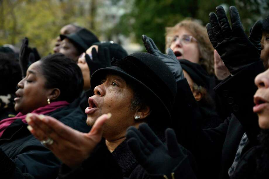 "Members of the gospel choir of St. Augustine Catholic Church hold a free concert in McPherson Square Park in Washington , D.C., in November. The parish is known as the ""mother church of African American Catholics"" in the District of Columbia. Photo: Washington Post Photo By Calla Kessler / The Washington Post"