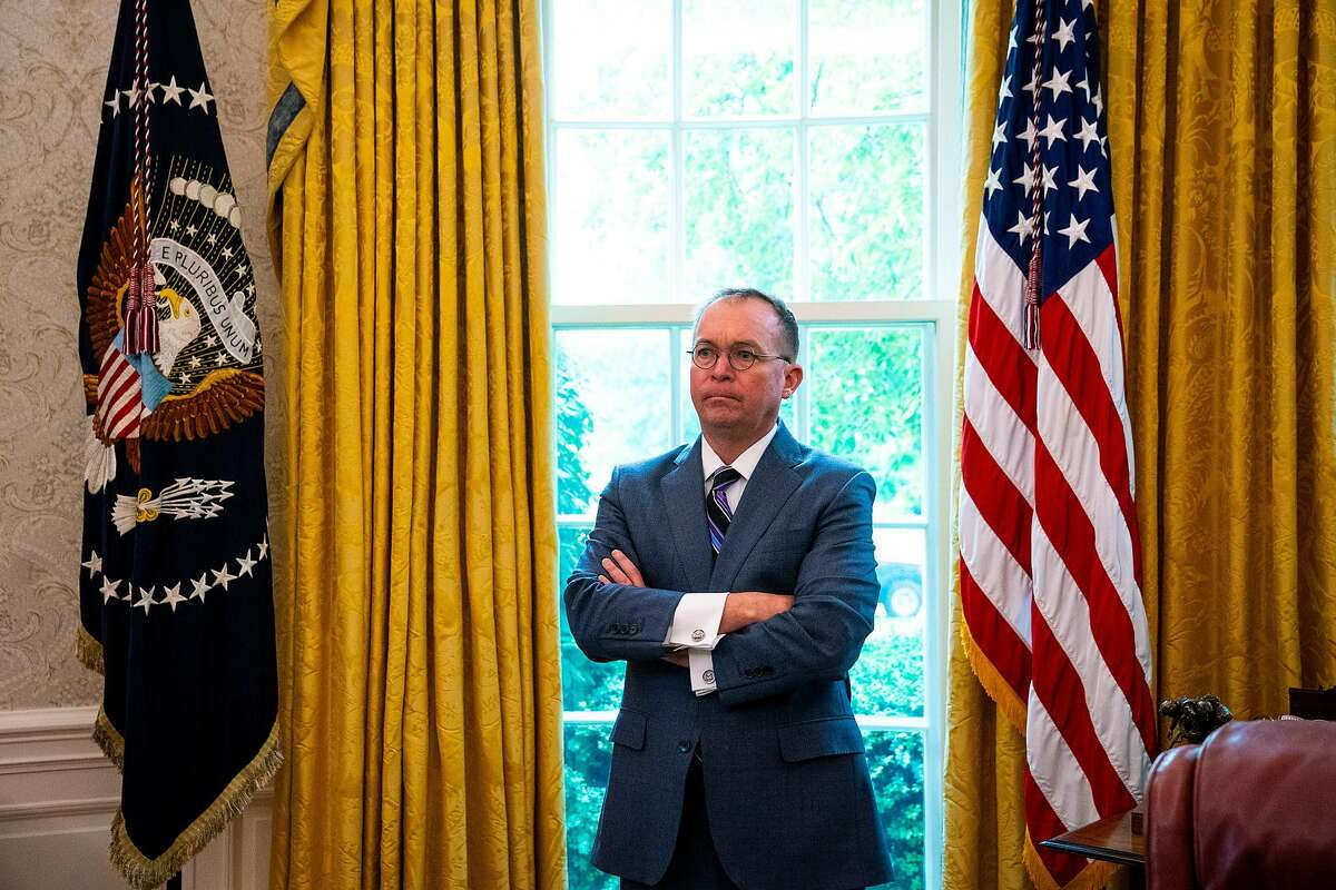Mick Mulvaney, the acting White House chief of staff, looks on as President Donald Trump meets with Prime Minister Viktor Orb�n of Hungary in the Oval Office of the White House in Washington, May 13, 2019. (Doug Mills/The New York Times)