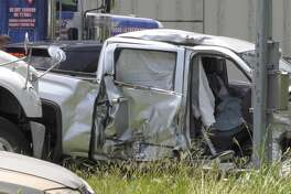 Houston police officers investigate a deadly T-bone crash on the U.S. 290 frontage road at Gessner on Monday, May 20, 2019.
