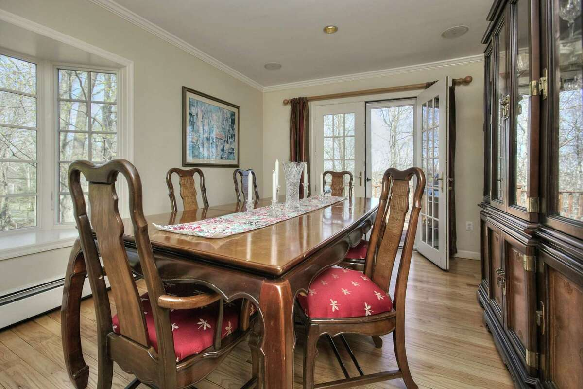 The formal dining room has a wet bar, bay window and French doors to the deck.