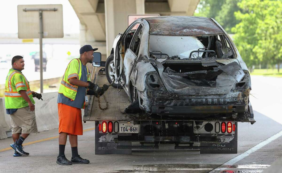 Houston Police officers and Houston Fire Department firefighters responded to the scene of a fatal car fire on the off ramp of the Eastex Freeway, near Tidwell Road Monday, May 20, 2019, in Houston.