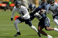 Seattle Seahawks strong safety Marquise Blair, left, closes in on wide receiver Floyd Allen, front, during NFL football rookie minicamp Friday, May 3, 2019, in Renton, Wash. (AP Photo/Ted S. Warren)