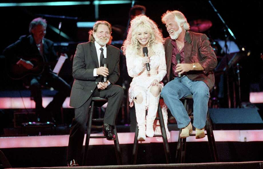 Willie Nelson, Dolly Parton and Kenny Rogers perform at Johnson Space Center for NASA staff and a May 20 broadcast in conjunction with the release of Rogers' latest album and video, May 2, 1989. Photo: Howard Castleberry, Houston Chronicle