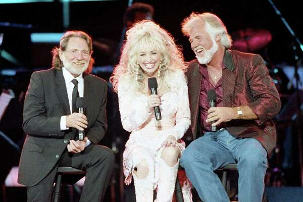 Willie Nelson, Dolly Parton and Kenny Rogers perform at Johnson Space Center for NASA staff and a May 20 broadcast in conjunction with the release of Rogers' latest album and video, May 2, 1989.