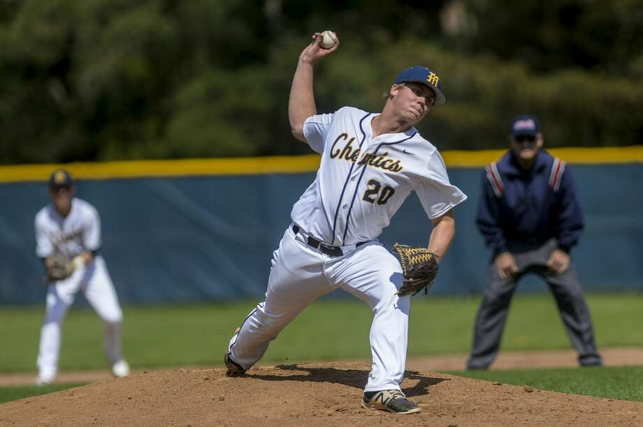 Midland High's Jeff Landis delivers a pitch vs. Dow High during a game earlier this season. Photo: Daily News File Photo