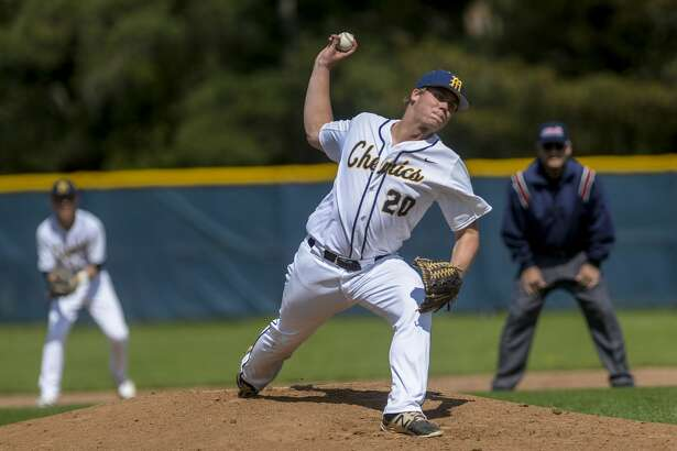 Midland High's Jeff Landis delivers a pitch vs. Dow High during a game earlier this season.