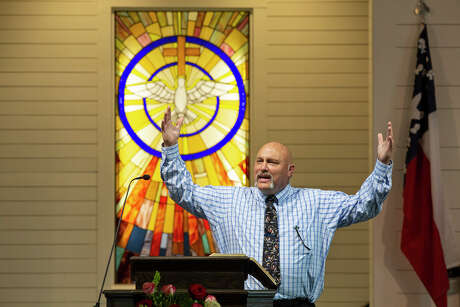Pastor Frank Pomeroy speaks from the pulpit during the private service for church members, survivors and victims' families, the first service held in the new building for First Baptist Church of Sutherland Springs, on Sunday, May 19, 2019.