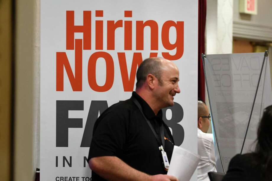 Representatives from GlobalFoundries were on hand to speak to job seekers during the annual Times Union technology, manufacturing job fair on Monday, May 20, 2019, at the Marriott in Colonie, N.Y. (Will Waldron/Times Union) Photo: Will Waldron, Albany Times Union / 20046987A