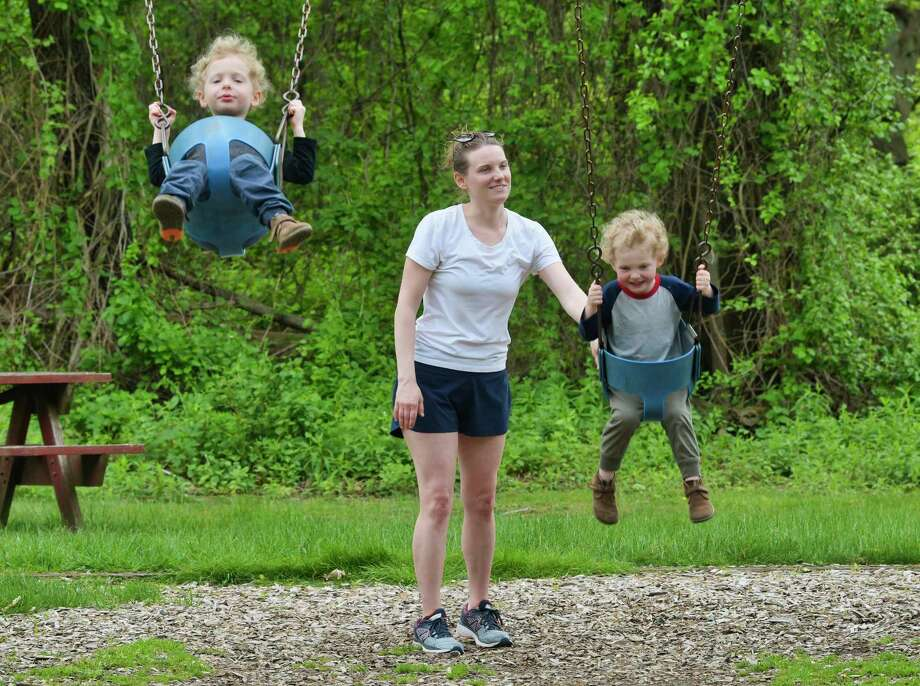 Christina Dillon of Albany pushes her twin sons, Tucker, left, and Conrad, three years old, on swings on Thursday, May 16, 2019, in Albany, N.Y.   (Paul Buckowski/Times Union) Photo: Paul Buckowski, Albany Times Union / (Paul Buckowski/Times Union)