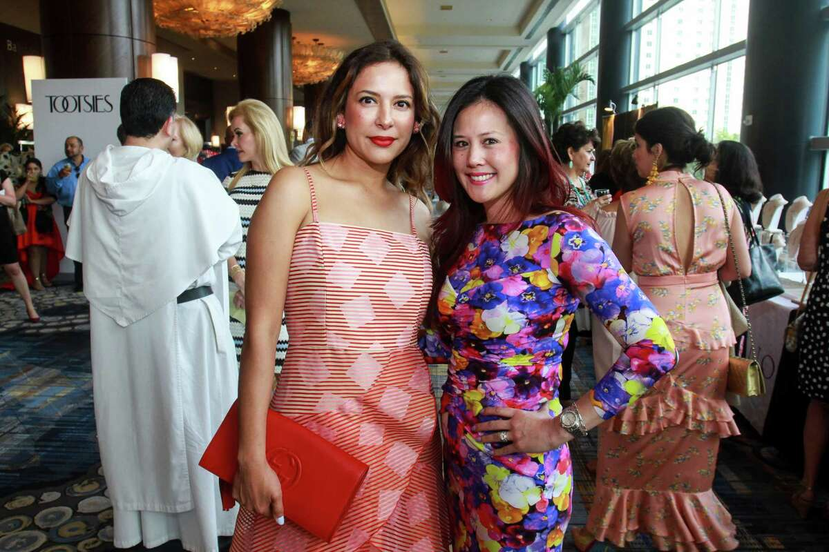 Angelina Dimassi, left, and Moya Quinones at the Latin Women's Initiative luncheon.