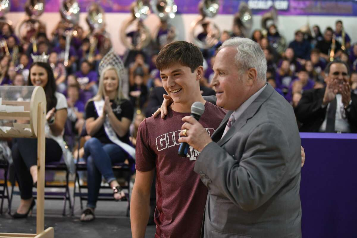 Bob Thewman general manager at Philpott Ford Hyundai introduces Brady Nail as Port Neches-Groves High School's winner of a new Ford EcoSport on Monday. Nail won the car from a name drawing of students with excellent attendance. Photo taken Monday, 5/20/19