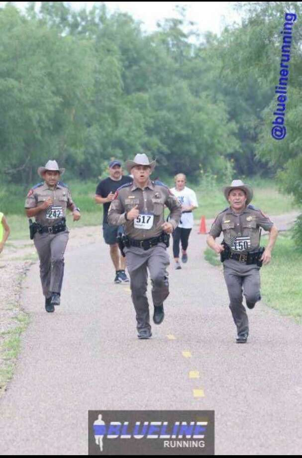 On Saturday, May 18, 2019 in Mission, Texas three state troopers wearing their full uniform and utility belts (guns and all) went for a run in the Back the Badge 5K. Photo: BLUE LINE Running/Isaac Juarez