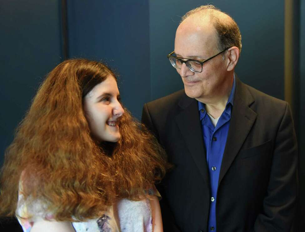 Elena Kaplan, 15, of Colonie is pictured with her father, Marc, at the Modern Day Music School on Monday, May 20, 2019, in Clifton Park, N.Y. (Will Waldron/Times Union)