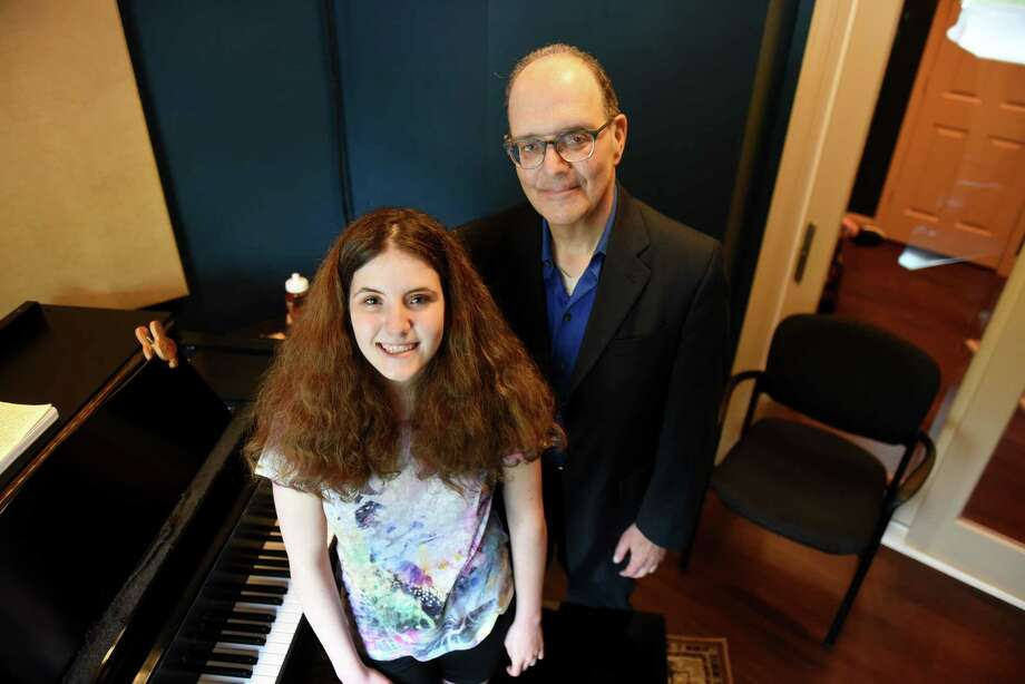 Elena Kaplan, 15, of Colonie is pictured with her father, Marc, at the Modern Day Music School on Monday, May 20, 2019, in Clifton Park, N.Y. (Will Waldron/Times Union) Photo: Will Waldron, Albany Times Union / 20046992A